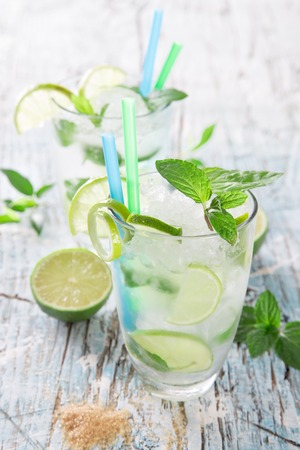 lime juice: Fresh mojito drink on wooden table