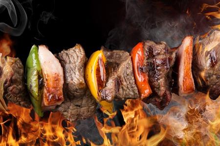 kabob: Tasty skewers on black background, close-up  Stock Photo