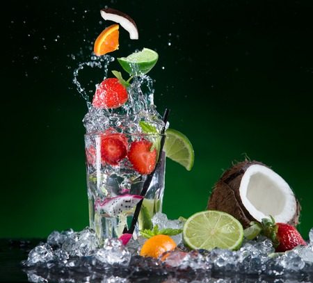 Fresh fruit cocktail in freeze motion splashing, close-up  photo