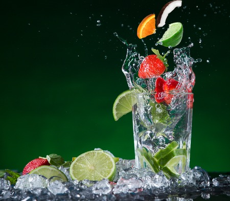 Fresh fruit cocktail in freeze motion splashing, close-up  photo