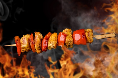 Tasty skewers with fire flames, close-up  photo