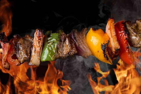 kabob: Tasty skewers with fire flames, close-up