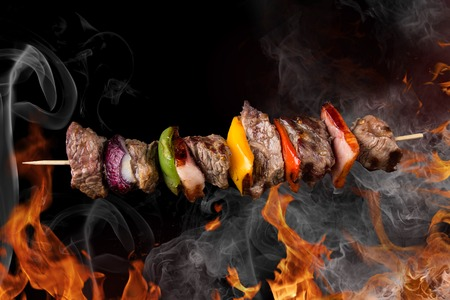 Tasty skewers with fire flames, close-up
