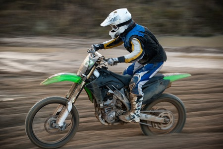 motocross: Motocross bike in a race, close-up