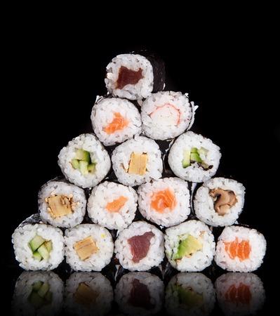 maki: Japanese seafood sushi set on black background