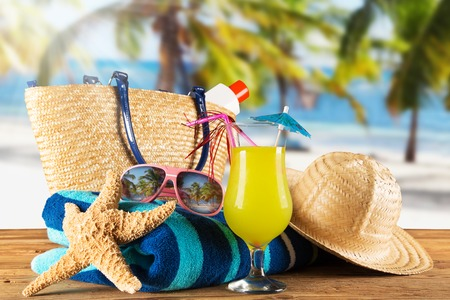 Close-up of summer accessories on sandy beach  photo