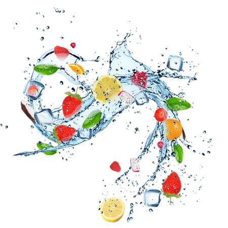 Fresh fruit with water splash over white  photo