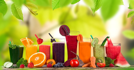 Fresh juice mix fruit, healthy drinks on wooden table  Imagens