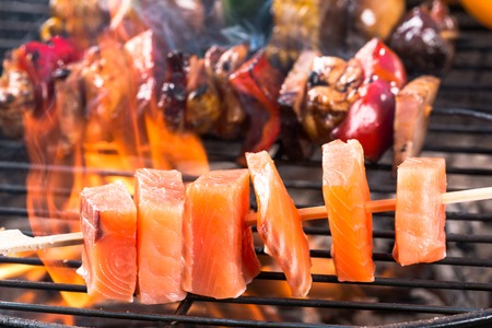 prawn skewers: Delicious salmon skewer on garden grill Stock Photo