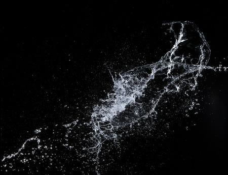 Water splashes over black background