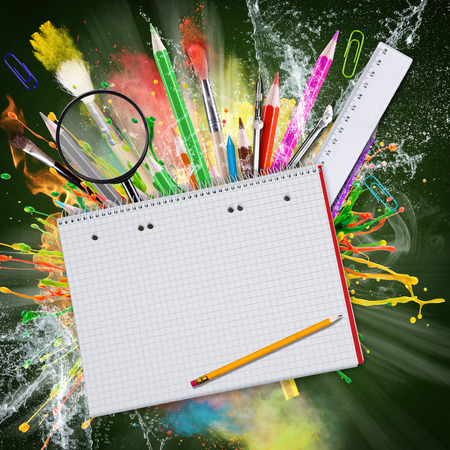 copyspace: School supplies with blackboard, abstract background, close-up