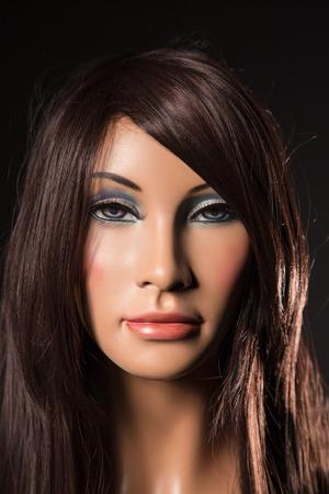 Portrait of brunette mannequin, close-up photo