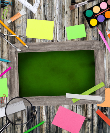 School supplies with blackboard, abstract background, close-up  photo