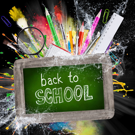 School supplies with blackboard, abstract background, close-up