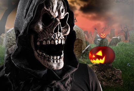 grim reaper reaper: Grim reaper on a dark background, halloween background. Stock Photo