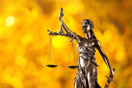 legal scales: Themis in spotlight - concept of justice.