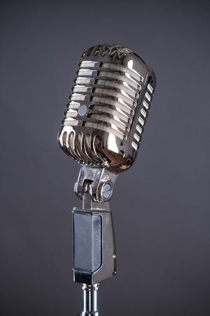 microphone retro: Retro microphone against grey background