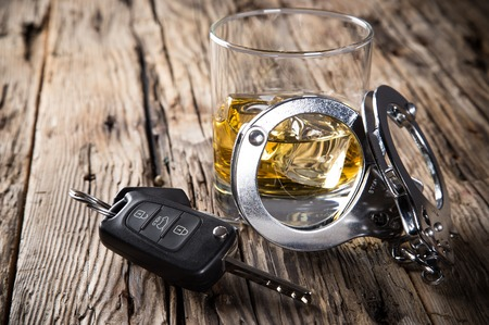 Glass of whiskey and car keys, drinking and driving photo