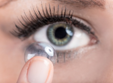 Closeup of a woman inserting a contact lens