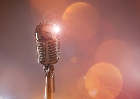 Retro microphone against colourful background photo
