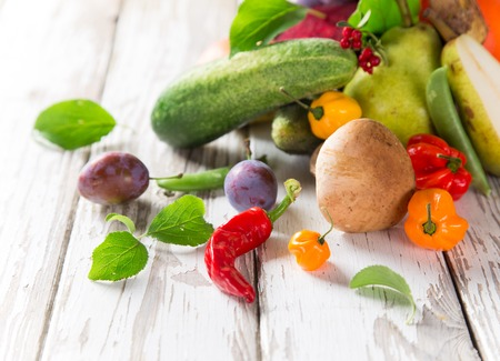 Healthy organic vegetable on wooden table, close-up. photo