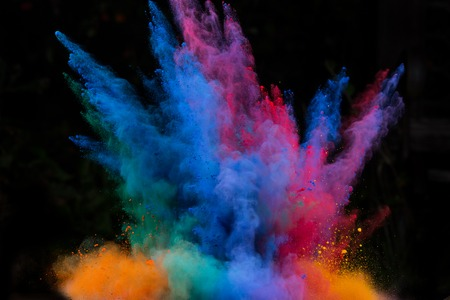 or color: Launched colorful powder, isolated on black background