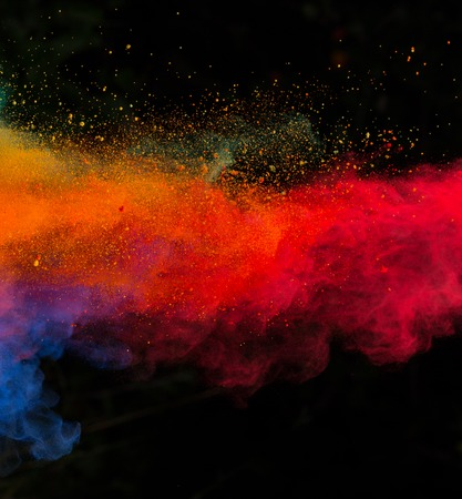 abstract: Launched colorful powder, isolated on black background