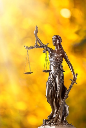 lady justice: Themis in spotlight - concept of justice.