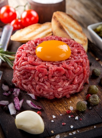 tartar: fresh beef tartar with egg, close-up.
