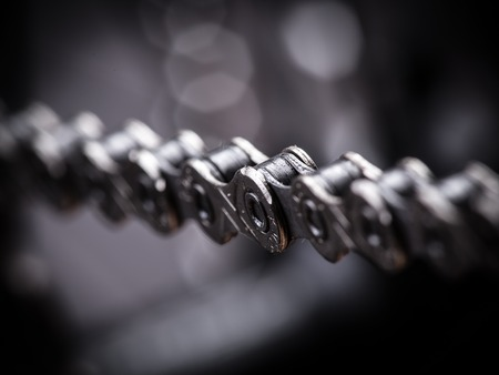 sprocket: Macro shot of mountain bike chain, studio shot.
