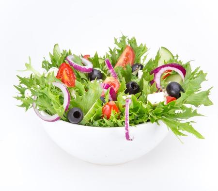 白い背景上に分離されて新鮮なおいしいサラダ 写真素材
