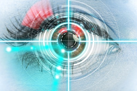 Close-up woman eye with laser medicine, technology concept. photo
