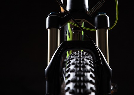 close-up of a mountain bike spring fork, studio shot. photo