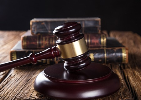 judge hammer: Wooden gavel and books on wooden table, law concept Stock Photo