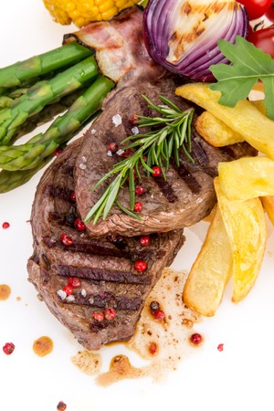 Delicious Beef steak on white background, close-up. photo