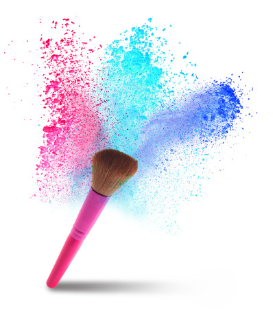 professional make-up brush with dust in motion. photo