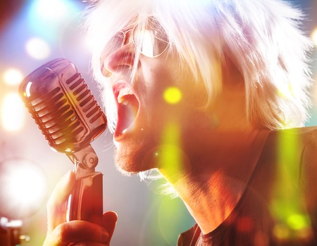 modern rock: Rock singer screaming on the retro microphone