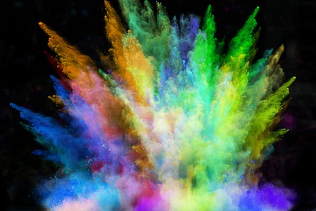 Colorful powder in freeze motion isolated on black background