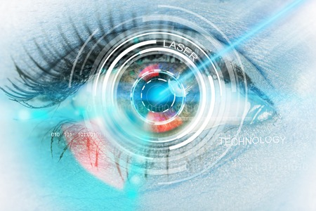 Close-up woman eyes with laser medicine, technology concept. photo