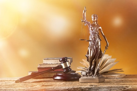 antique scales: Themis in spotlight - concept of justice.