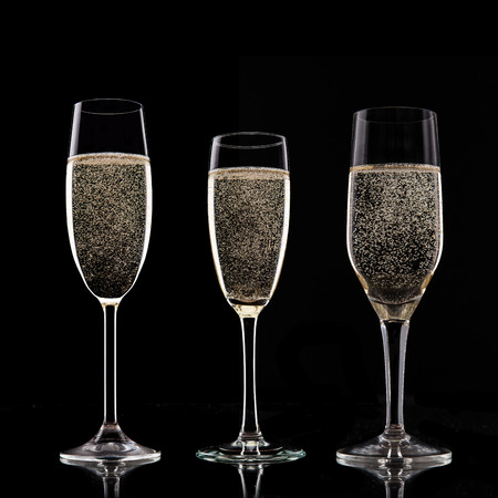 Champagne glasses on black background. photo