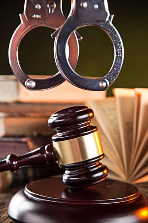 criminal justice: Wooden gavel and books on wooden table, law concept Stock Photo