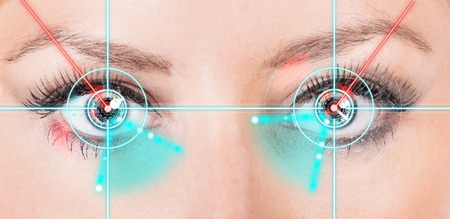 eyes contact: Close-up woman eyes with laser medicine, technology concept. Stock Photo
