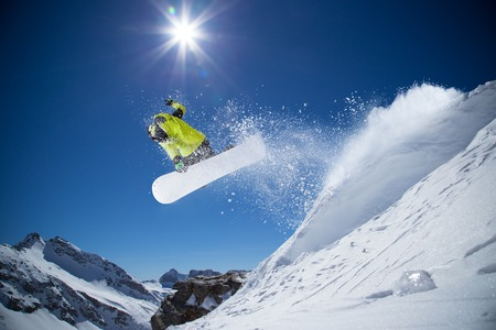 ski lift: Snowboarder in high mountains during sunny day.