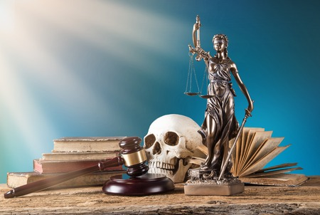 Themis in spotlight - concept of justice. photo