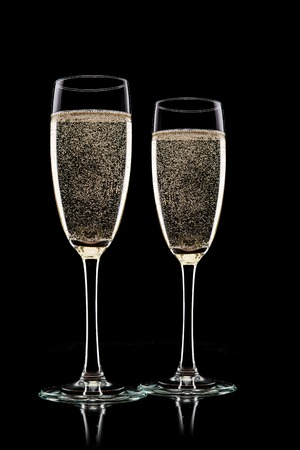 Champagne glasses isolated on black background photo