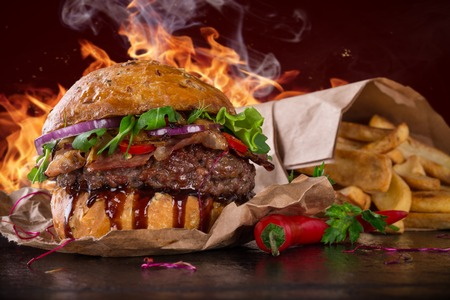 huge: Delicious burger with fire flames Stock Photo