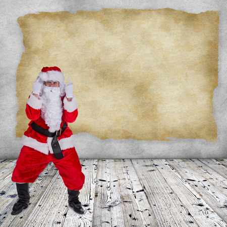 upraise: Santa Claus with upraise middlefingers, concept of Christmas hatred. Stock Photo