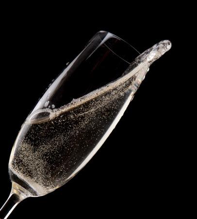 Champagne flute on black background, celebration theme. photo