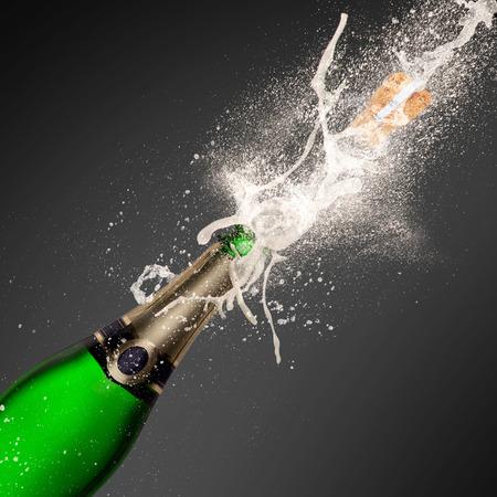 Champagne explosion on black background, celebration theme. photo